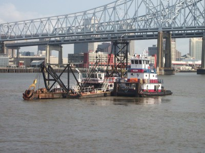 moving-a-dredge-on-the-Mississippi-1-400×300